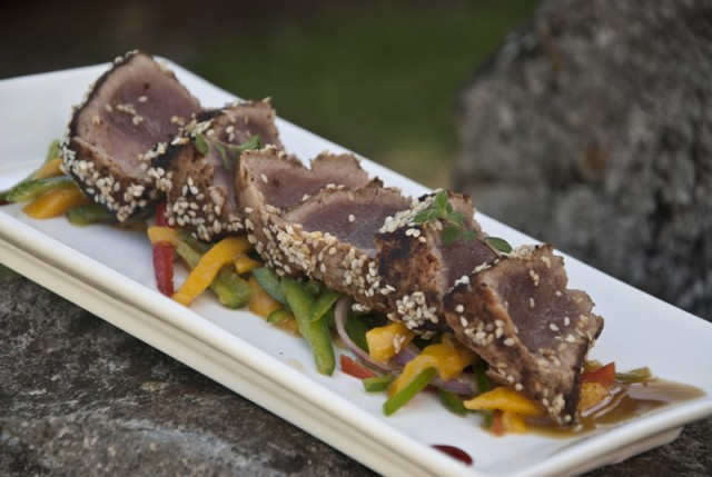 healthy food at atmosphere with seared tuna with sesame seeds