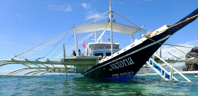 Atmosphere dive vessel Victoria, moored up by Apo island