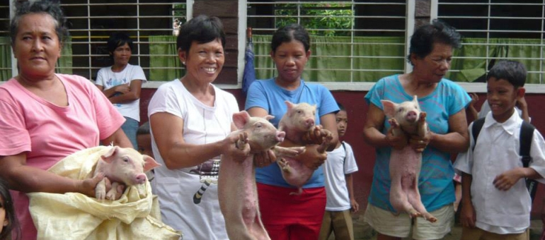 The mothers at the Atmosphere Soup Kitchen showing off their Piggy Bank