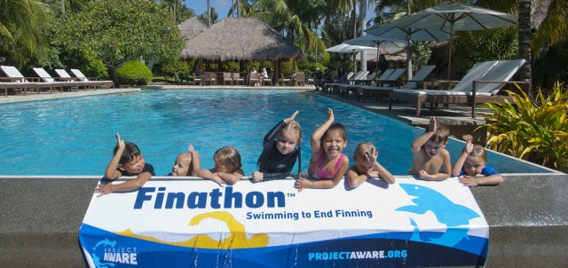 Kids supporting Project Aware in the Atmosphere Resort Pool in the Philippines