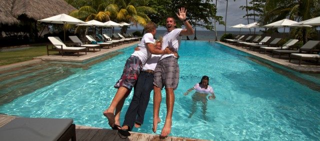PADI Course Director Gabrielle Holder sandwiched between two happy new PADI Instructors