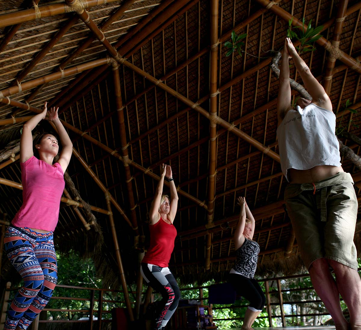 Rylyn Ge, Ulrika Kroon and Rae Collins in a yoga class with Tim Feldmann at Atmosphere Resort Philippines