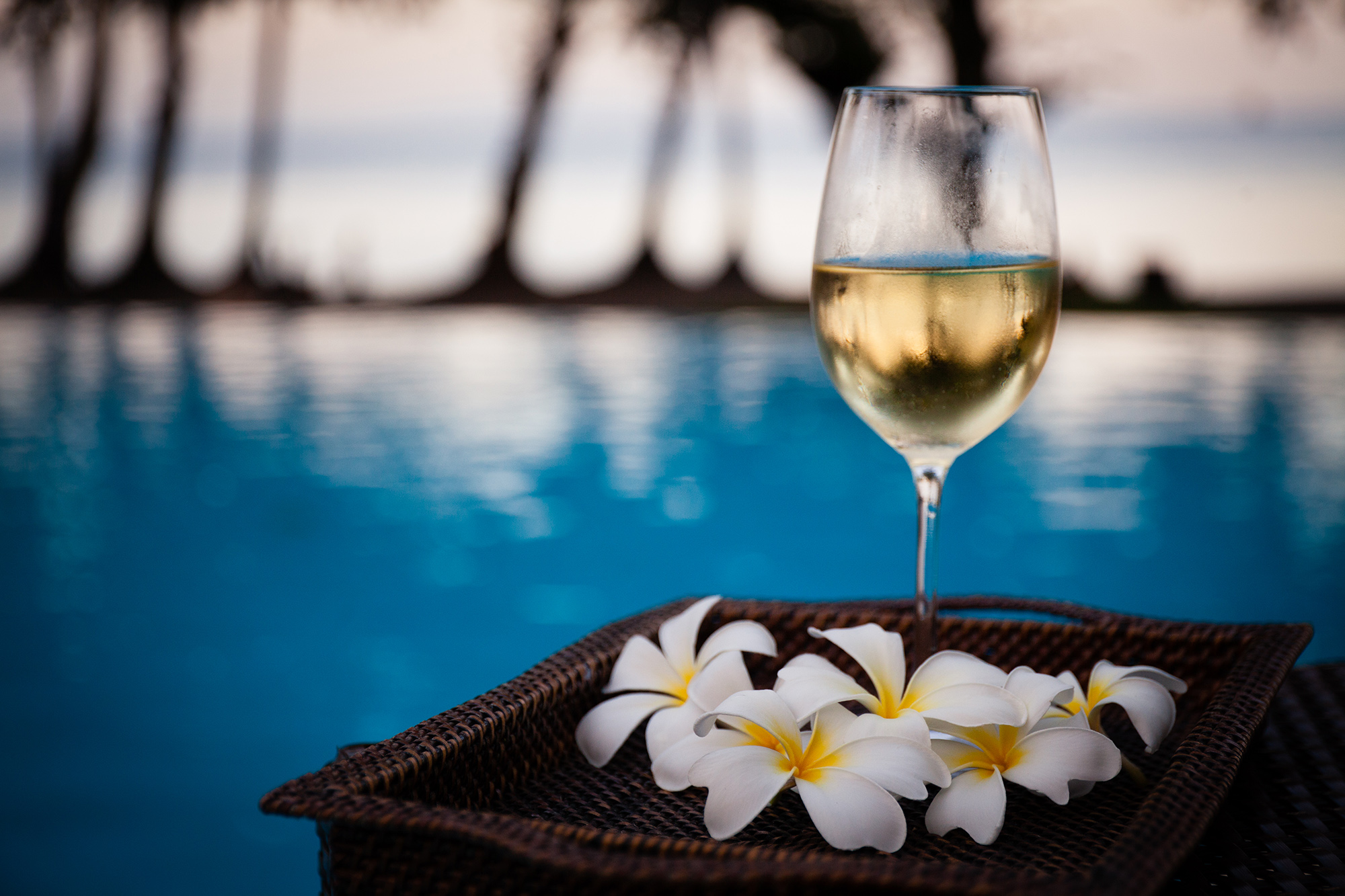 Wine by the infinity pool