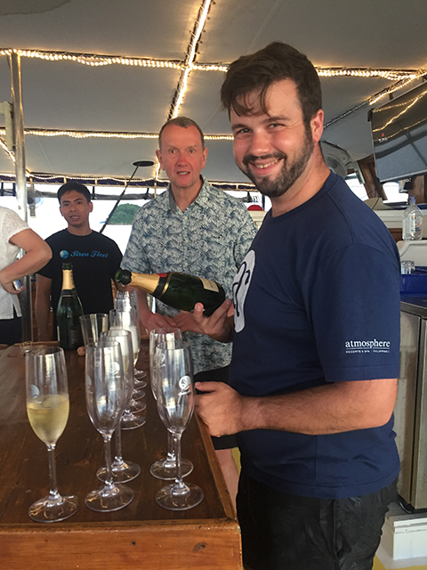 Adam opening the Champagne on the Palau Siren 2017