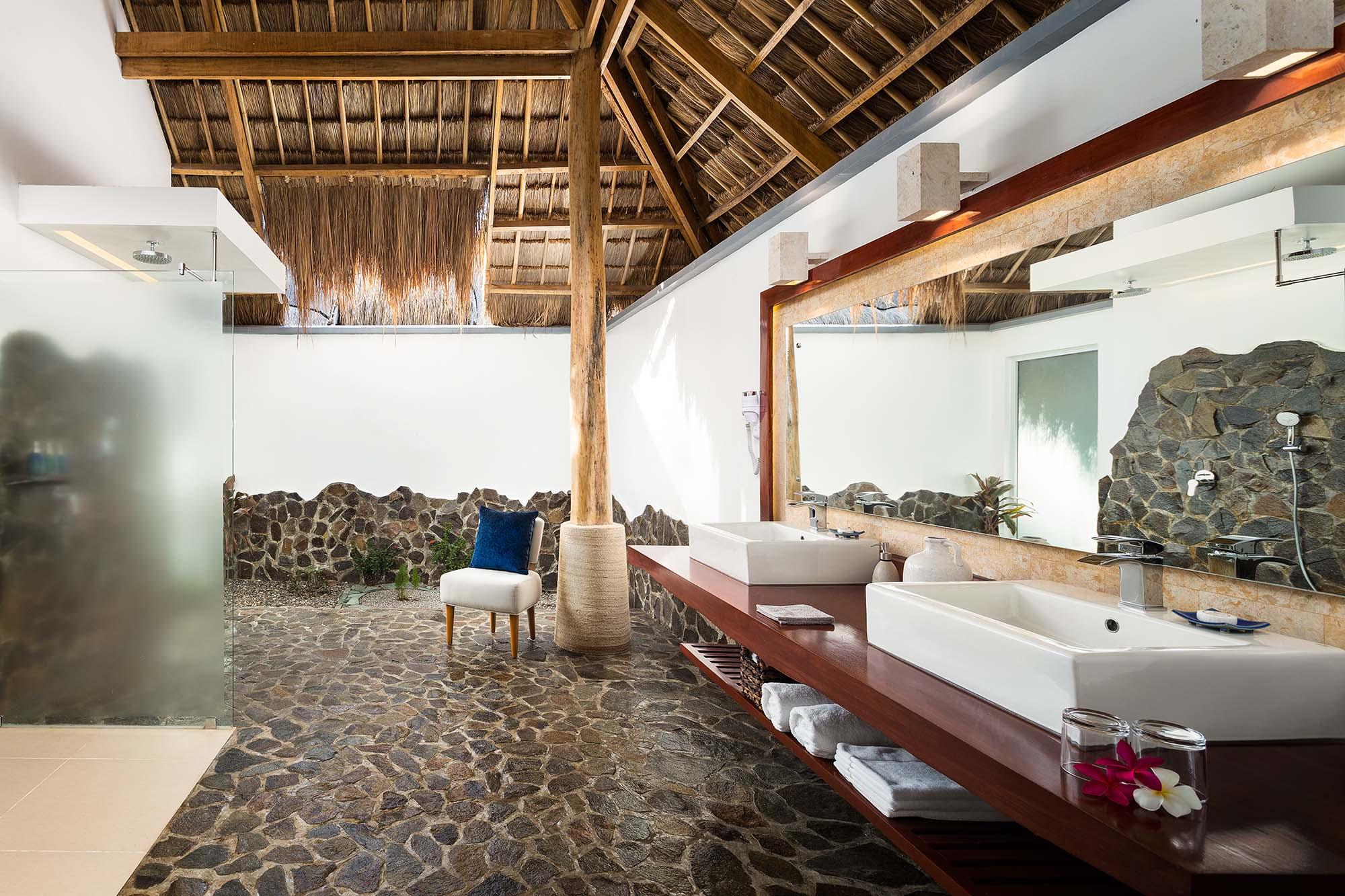 Bathroom in a Premium Pool Suite in Atmosphere resorts & Spa Philippines