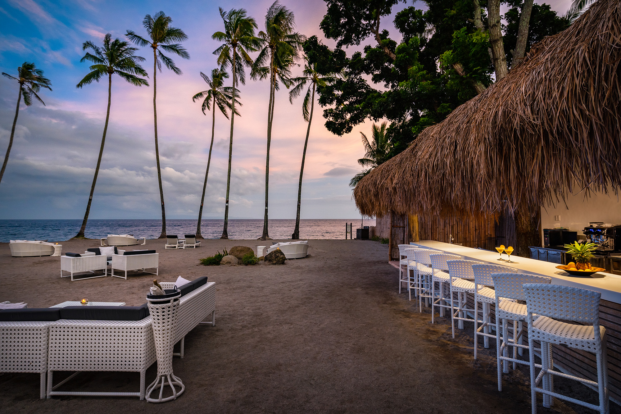 The Beach Bar at Atmosphere Resort, Philippines, overlooks the beach and ocean