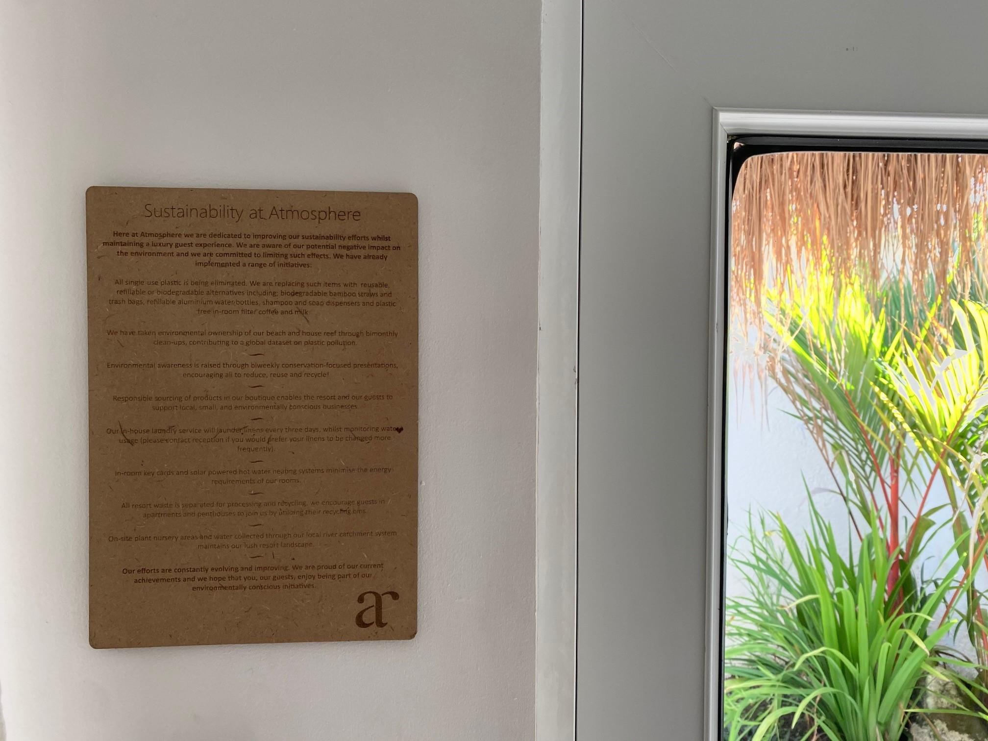 Sustainability at Atmosphere on-room sign